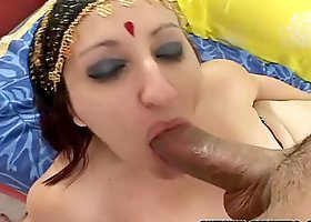 Horny Indian babe gives titjob and gets fucked doggystyle