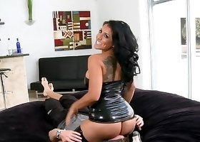 Latex wearing brunette with a big booty facesitting a guy