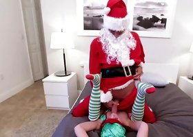 Cute elf Lizzie Bell fucks the big cock Santa for Christmas