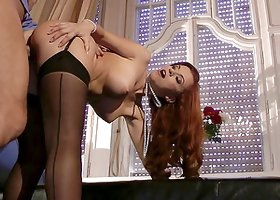 Adorable redhead with fake tits enjoys a hardcore doggy style pounding