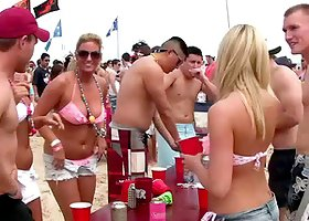 Alluring cowgirl in glasses getting drunk at the beach party outdoor