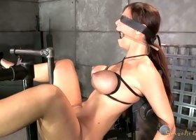 Bosomy blind folded MILF Syren De Mer restrained in bdsm device