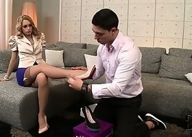 She tries on shoes and then tries out her feet on his pecker