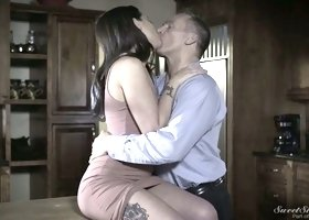 Romantic babe Gia Paige lies on the table and swallows a meaty cock