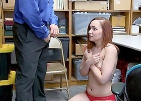 Redhead April Reid has to fuck with a security guard in the office
