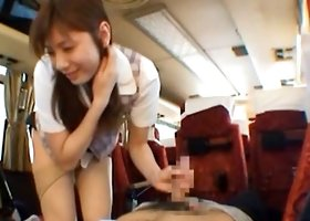 Hot stewardess Yuma Asami sucking the captains cock on board