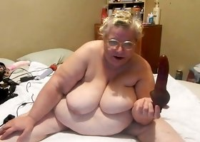 Awful extremely obese mature whore in glasses was ready to flash her tits
