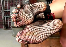 Sexy Brunette In Fishnet Stockings Gives Out Footjob & Gets Fucked