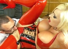 Blond porn star fucks on desk in red latex
